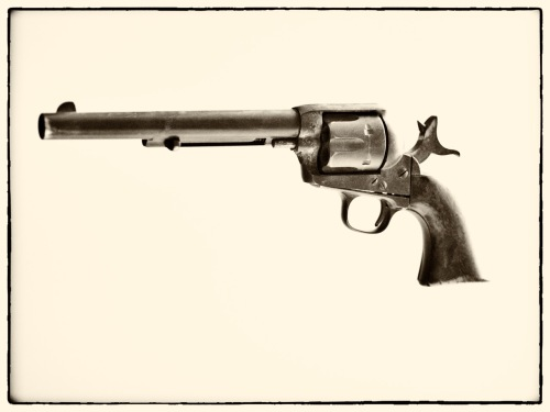 Jasper Parrett's .44 caliber gun, manufactured by Colt in 1875. It weighs 2 lbs., 14 oz.--too heavy to twirl on your finger, cowboy-style.